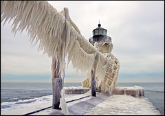 Ice on St. Joe Light (Tom Gill.) Tags: winter lighthouse lake ice pier frozen michigan stjoseph lakemichigan icicles catwalk icecovered outerlight