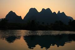 Magical atmosphere (deus77) Tags: china sunset panorama mountains reflection silhouette reflections river landscape yulong guilin yangshuo silhouettes peak  peaks karst  guangxi    flickraward  platinumheartaward  flickraward5