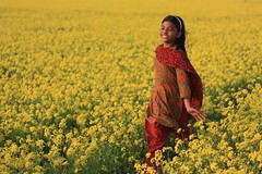 Rise and shine baby, rise and shine (ShohorBondi ) Tags: red green girl smile yellow mustard bangladesh mustardfield tania tora manikganj adnanarsalan canoneos1000dcanon50mmf18ii riseandshinebabyriseandshine southtora