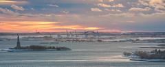 NY Harbor Monday Evening (Jay Fine) Tags: nyc sky snow clouds landscape cityscape dusk nj cranes ellisisland nyharbor