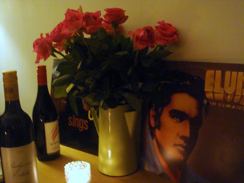 Beautiful scented roses on the table, our BYO wine... and Elvis