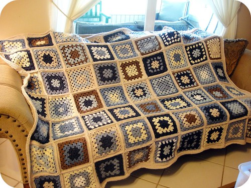 completed crocheted granny square afghan