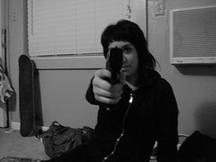 Fresno (C>M>Photography) Tags: california shadow white black film girl face youth analog 35mm real 22 photo eyes gun hand minolta random five girly central young photograph fresno valley pistol illegal skateboard guns himatic af2 bangs piece fecal gat ruckus firearm thirty millimeter
