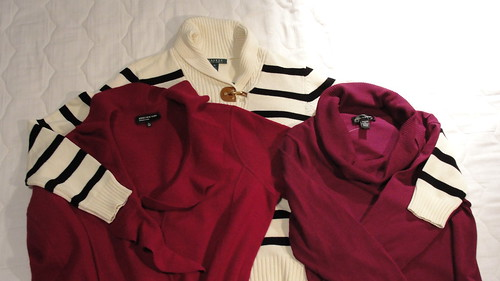 Photo of a black and white striped sweater, a raspberry colored jacket and a magenta sweater