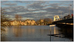 Deventer sur mr..........part II (Zino2009 (bob van den berg)) Tags: bridge sunset people nature sunshine river stream wilhelminabrug glow flood centre watching sunny avond welle picnik highlevel deventer overstroming crowded flooded mensen rivier hoogwater ijsselbrug sonlicht deijssel ijsselhotel bobvandenberg bobphotography