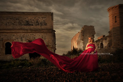 Lady in Red (T. Zettlemoyer) Tags: red portrait castle lady spain ruins wind gothic pregnant medieval maternity moorish satin rotaspain tiffanyzettlemoyer