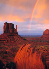 Rainbow in Monument Valley (Utah Images - Douglas Pulsipher) Tags: travel sunset arizona southwest landscape evening utah rainbow sandstone scenery glow desert empty indian scenic nativeamerican rainstorm glowing lonely indians wilderness navajo southernutah monumentvalley isolated southwestern buttes indianreservation themittens virga utahdesert tribalpark southwesternscenery southwesternlandscape southernutahdeserts