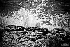 Rocas (Oscar.vng) Tags: barcelona sea bw byn blancoynegro rock stone canon eos mar blackwhite rocks stones bn foam sitges garraf rocas 2010 espuma 400d 2010photos ao2010 2010year fotos2010 oscarvng