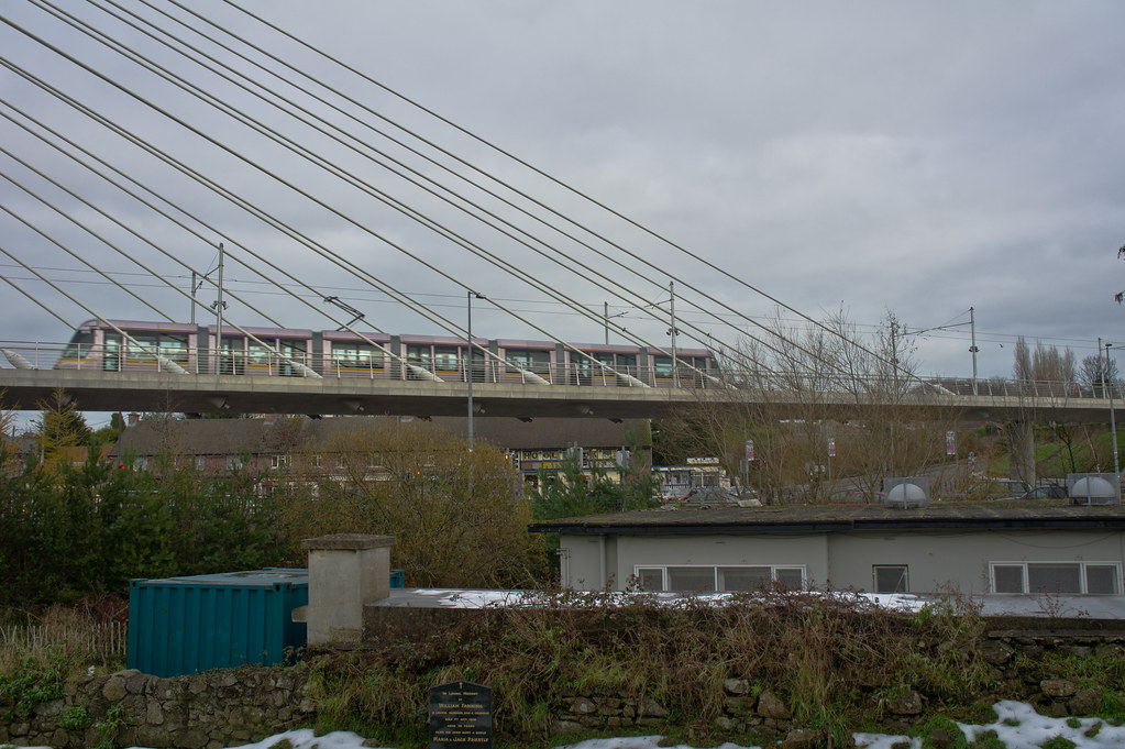 Luas Tram Crossing William Dargan Bridge - Viewed From St. Nahi's Graveyard