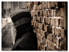 another brick in the wall (Jordan_K) Tags: life street city boy people brick wall photography escape message artistic politics perspective bodylanguage cage reality destination feeling montevideo capitalism society citizens freeme thoughtcontrol