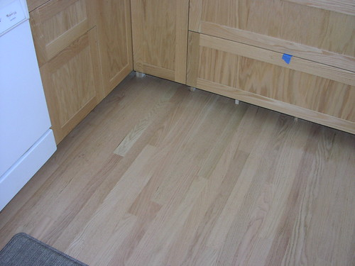 Unstained red oak floor & cabinets