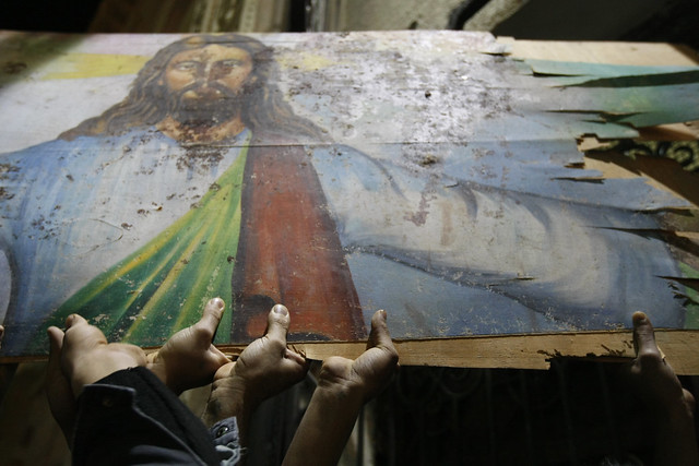 Egyptian Christians Hold Blood-Stained Portrait of Jesus Christ