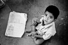 wth? (knowsnotmuch) Tags: boy pencil book kid kodak iso400 nikonf100 hyderabad scribbling paigahtombs