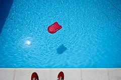 swimming pool (Zioluc) Tags: blue red sun water pool shoes float kickboard luciobeltrami
