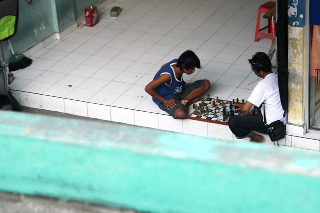 Friends playing chess in Kuta, Bali