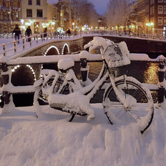 Snow covered bike in the heart of Amsterdam (Bn) Tags: city winter snow cold holland netherlands dutch amsterdam weather bike bicycle night lights canal topf50 sneeuw bridges freezing bikes covered biking prinsengracht snowfall letitsnow topf100 mokum grachten cosy jordaan winterwonderland fiets dusting freshsnow gracht leliegracht sfeer whitebike 100faves 50faves snowinamsterdam 6celcius canalsofamsterdam saariysqualitypictures mooiamsterdam hollandinthewinter steepbridges