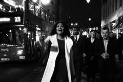 (Che-burashka) Tags: street party people urban blackandwhite bw woman bus london smile lady night energy joy citylife places bn celebration goodmood walkers 2010 oxfordst londonist canonef28mmf18usm