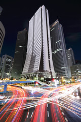 Sompo Japan Building (planet-110) Tags: city longexposure light urban building japan architecture night tokyo shinjuku stream traffic trail   intersection    sigma1020mmf456exdchsm