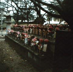 Unusual Memorial (katizabitwhite) Tags: red japan analog children photo memorial caps odd