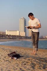 the reader (goodstav) Tags: barcelona beach 50mm book jump jumping sand magic levitation barceloneta trick polarizer