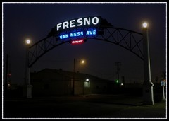 Foggy Fresno Arch (Dusty_73) Tags: california old evening gate downtown neon arch central foggy entrance landmark fresno valley gateway van avenue ness vanness