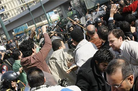 Egyptian demonstrators are confronted and attacked by the security forces who sought to curb the mass protests that swept the country on Friday, Jan. 28, 2011 in the aftermath of prayers. The revolutionary upsurge that started in Tunisia has spread. by Pan-African News Wire File Photos
