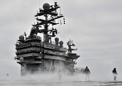 Sailors check the sprinkler heads during test of countermeasure wash down system. (Official U.S. Navy Imagery) Tags: ship navy sailors armada sailor usnavy carrier flightdeck ussharrystruman marineros