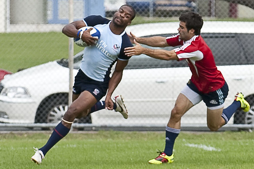 Miles Craigwell runs past an Argentine player during a warm-up game before the Wellington Sevens in February 2011.