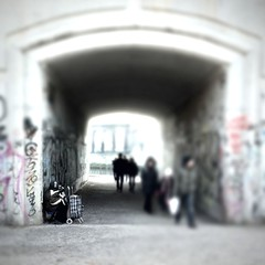 On the edge. (Sascha Unger) Tags: street light people urban berlin art wall germany underground licht traffic angle centre perspective tunnel center menschen stadt sascha spree bahn mitte verkehr perspektive beton mauer museumsinsel iphone unterfhrung tiltshift akkordeon monbijoupark stadtbahn passanten coolfx strassenmusikant tiltshiftgenerator tiltshiftgen hipstamatic sascha2010 saschaunger