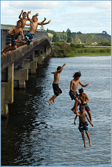 Summer Plunge (Catching Magic) Tags: bridge newzealand summer lake water swimming nikon tiraudan karapiro horahora