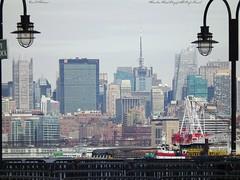 towers of manhattan. (ksk photography) Tags: nyc newyorkcity skyscrapers crane manhattan tugboat hudsonriver barge bankofamericatower onepennplaza newyorktimestower fourtimessquare