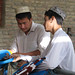 Uyghur men sorting strands of dyed silk - Hotan, Xinjiang