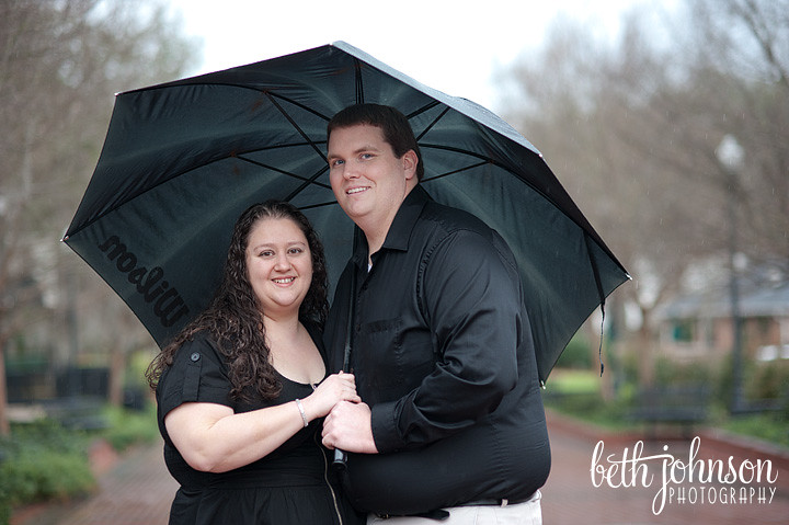 tallahassee couple dressed in black with a black umbrella in the rain