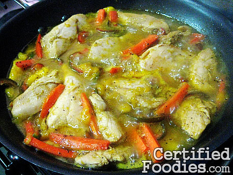 Let the chicken, mangoes, carrots, pepper and everything else simmer for 5-8 minutes - CertifiedFoodies.com