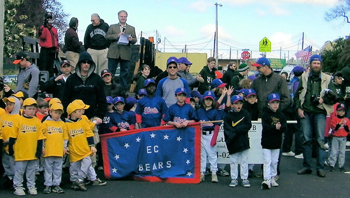 El Cerrito Youth Baseball teams watch the introduction of teams during opening day ceremonies Feb. 26 on Pomona Avenue next to Cerrito Vista Park.
