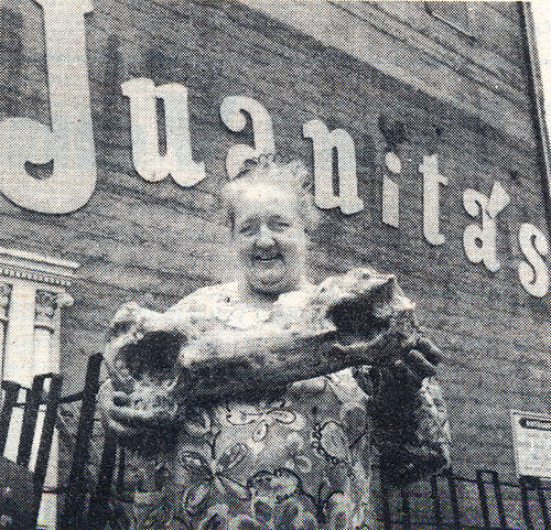 Juanita Musson pictured in a 1975 edition of the Port Costa newsletter<br /> The Unnatural Enquirer, holding one of the Pre-Credulous Era Port Costa findings created by Dr. Gladstone, aka artist Clayton Bailey. Photo by Lewis Stewart.