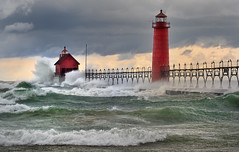Grand Haven Lighthouse - Grand Haven, Michigan (Michigan Nut) Tags: red usa beach geotagged photography waves spray stormclouds grandhavenlighthouse lakemichiganstorm michigannutphotography