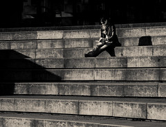 reading on the stairs (pamela ross) Tags: shadow blackandwhite bw sun stairs pen 50mm reading book minolta hamburg olympus michel ep1