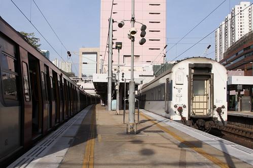 Through Train overtaking a MTR train at Sha Tin station