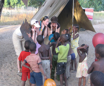 Children from the Teemacane village 'Kaputura' and WUSC students engaged in play
