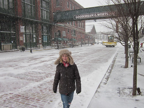 Walking down Mill Street during a snow storm in Toronto in the historical distillery district