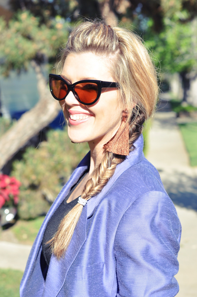 fishtail braid and cat eye sunglasses