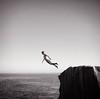 (brianoldham) Tags: ocean boy sky blackandwhite cliff fall water rock jump jumping horizon falling 365 brianoldham