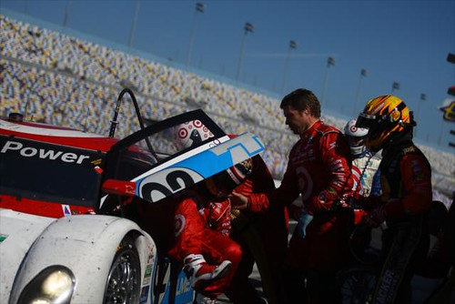 Juan Pablo climbs out of the #02 while Jamie McMurray waits to jump in