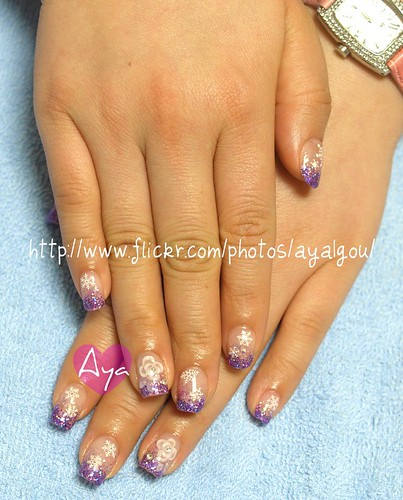 Purple glitter tips with snowflakes and flowers