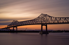 50mm's Worth (Bruce Bordelon) Tags: bridge light sunset blur water clouds port river mississippi rouge 50mm evening nikon louisiana long exposure downtown f14 smooth filter nikkor baton stacked seconds horace density wilkinson neutral 486 10stop d700 6stop