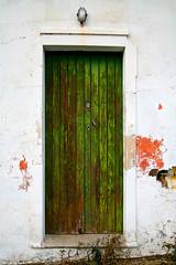 A green one (steverichard) Tags: door wood travel house green texture portugal wall photo casa europe closed peeling paint image decay roadtrip step entrada porte portal pt flaky shut iberia viajar tore turen mertola steverichard srichardimages