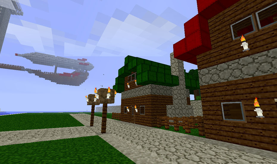 Minecraft - The first few houses, with my Airship in the background