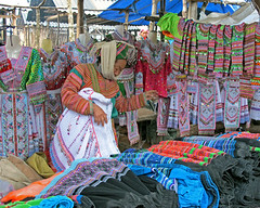 Clothes Seller a Hmong Market (Mike Colyer) Tags: family buffalo market terraces vietnam sapa hmong