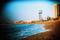 barcelona beach (lomokev) Tags: barcelona sea building beach water xpro lomography crossprocessed xprocess vignetting vignette deletetag lomographyxpro200 roll:name=100701holga35lomoxpro200 file:name=100701holga35lomoxpro200003